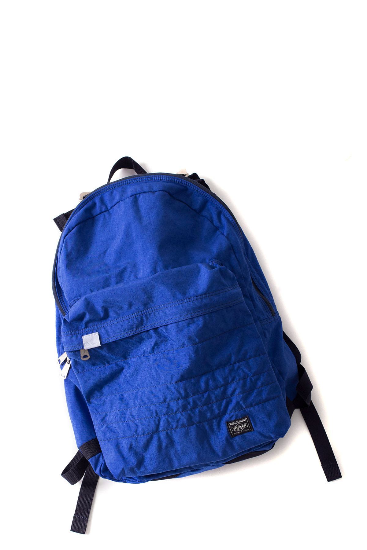 WHITE MOUNTAINEERING : WM x PORTER Garment Dyed Backpack (Blue)